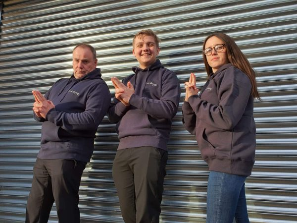 The team wearing the 'Original' Summit Garage Hooded Sweatshirt