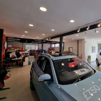 Summit Garage new showroom front window Aug 2021